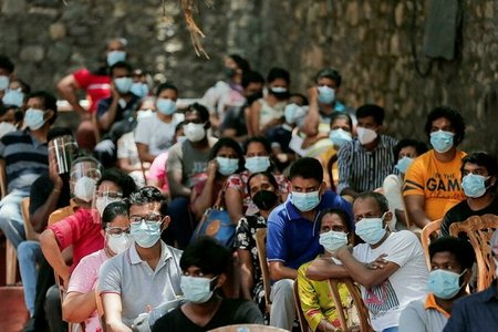 Covid-19: GDP thế giới có thể mất 2.300 tỉ đô la do tiêm chủng chậm
